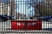 A big red Stop barricade behind the gate