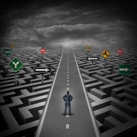 picture of confusing  - Crisis solution concept as a businessman standing on a straight road through a maze or labyrinth with confusing direction road signs as a metaphor for finding the answer to a riddle as a clear strategy to overcome difficulties in business and the problems - JPG
