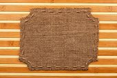 Frame Of Burlap, Lies On A Background Of  Bamboo Mat