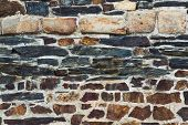 Wall made of different stones