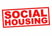 stock photo of social housing  - SOCIAL HOUSING red Rubber Stamp over a white background - JPG