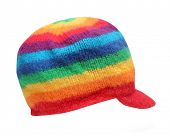 Rainbow rasta cap isolated on a white background. Homemade knitted product.