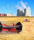 Industrial landscape with different energy resources. Biomass, wind power and atomic energy.