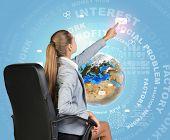 Businesswoman pressing envelope icon on virtual interface
