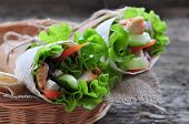 fresh vegetables in pita bread, with the boiled chicken, olives and Feta cheese