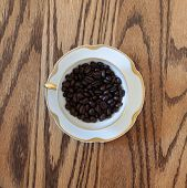 Cup filled coffee beans