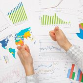 Business Man Working With Financial Data - Thumbs Up - Focus On Graphs