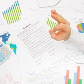 Business Man Working With Financial Data - Ok Sign