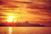 Silhouette of coastal city in beautiful orange sunset light, gorgeous cityscape, panoramic landscape, summer travel, Beirut, Lebanon