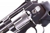 picture of revolver  - Macro shot of a stainless steele revolver - JPG