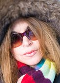 image of close-up middle-aged woman  - Beautiful middle age woman close up portrait wearing a thick coat in the Canadian Winter - JPG
