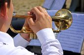 image of trumpets  - Musician playing on trumpet in the street orchestra - JPG
