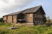 stock photo of wooden shack  - Old large wooden house in northern Russian village - JPG