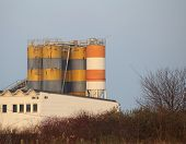 picture of silos  - Striped silos on top of a factory building - JPG