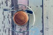 Coffee cup on wooden table in vintage