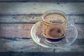Empty coffee cup in vintage on wooden table