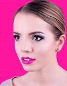 Portrait of young woman, on pink background