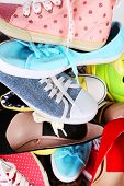 Many various female shoes close-up background