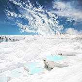Beautiful blue travertine pools and terraces in Pamukkale Turkey
