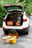 Suitcases and bags in trunk of car ready to depart for holidays