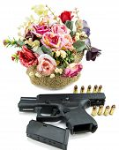 picture of broken heart flower  - handgun pistol and flower on white background - JPG