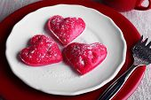 Cookies in form of heart in plate with cup of coffee on napkin background