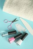 French manicure set with white tip polish, and top coat shine applicator for nails on color background
