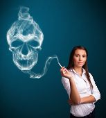 pic of dangerous  - Pretty young woman smoking dangerous cigarette with toxic skull smoke  - JPG