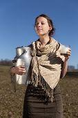 Young Pretty Peasant Woman Drinking Fresh Milk