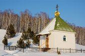 Chapel Village In Siberia
