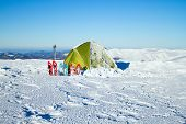 picture of tent  - Tent stands in the mountains in the snow - JPG