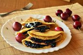 stock photo of crepes  - Homemade crepes with fresh cherries on the white plate - JPG