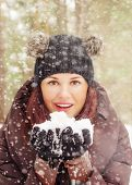 Cute Young Woman Playing With Snow  Outdoors