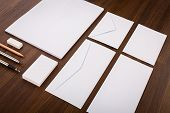 Blank Template. Consist of Business cards, letterhead a4, pen, envelopes,pencil,eraser on wood table