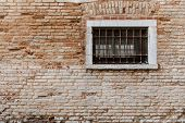 Ancient Brick Wall Texture. Window With Grill And Railings. Venice Italy