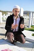 Young muslim man showing Islamic prayer
