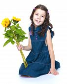 pretty little girl with a bouquet of yellow flowers in hand.