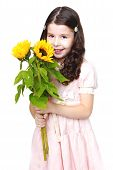 smiling girl with big bouquet of yellow flowers.