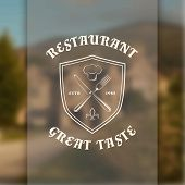 Restaurant logo template with shield, knife and fork, on blurred vintage background