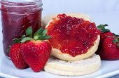 stock photo of jar jelly  - Strawberry Jam spread onto an English Muffin - JPG