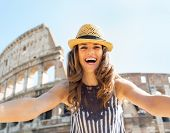 Happy Young Woman Making Selfie In Front Of Colosseum In Rome, I