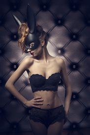 picture of bunny costume  - fashion glamour shoot of cute woman with perfect body wearing sexy lace lingerie and bizarre black bunny mask - JPG