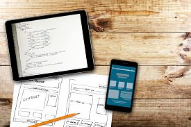 picture of analysis  - website wireframe sketch and programming code on digital tablet - JPG