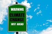 image of warning-signs  - Warning Climate Change Just Ahead written on green road sign against clear blue sky background - JPG