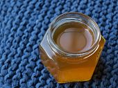 Opened jar of honey