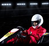 picture of karts  - Young woman karting racer at stadium - JPG