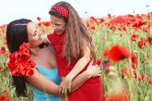 stock photo of preteens  - Mother and her 7 years old preteen child playing in spring flower field - JPG