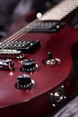stock photo of musical instrument string  - Electric guitar mahogany lies on the black leather jackets vertical composition a stringed musical instrument electronic control bodies six - JPG