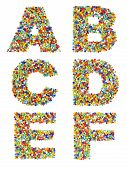 picture of beads  - Letters of the alphabet A through F made from colorful glass beads on a white background - JPG