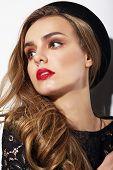 stock photo of hottie  - Portrait of Young Trendy Woman in Black Hat - JPG